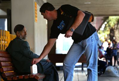 Man giving charity to a beggar
