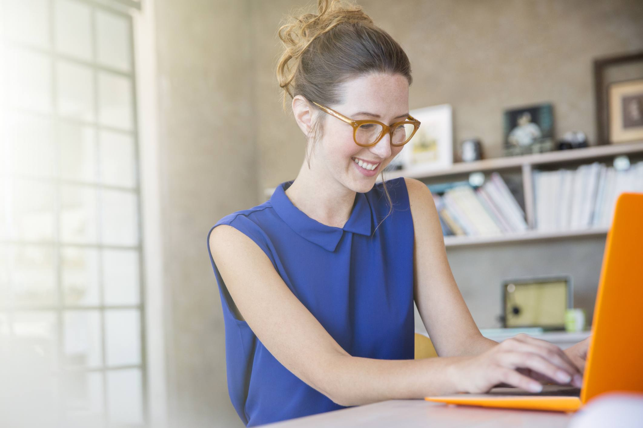 Woman at computer in home office