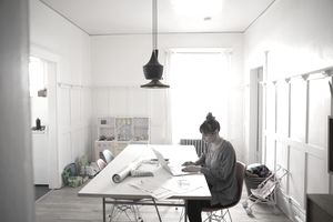 freelance designer working from home studio that also doubles as child playroom