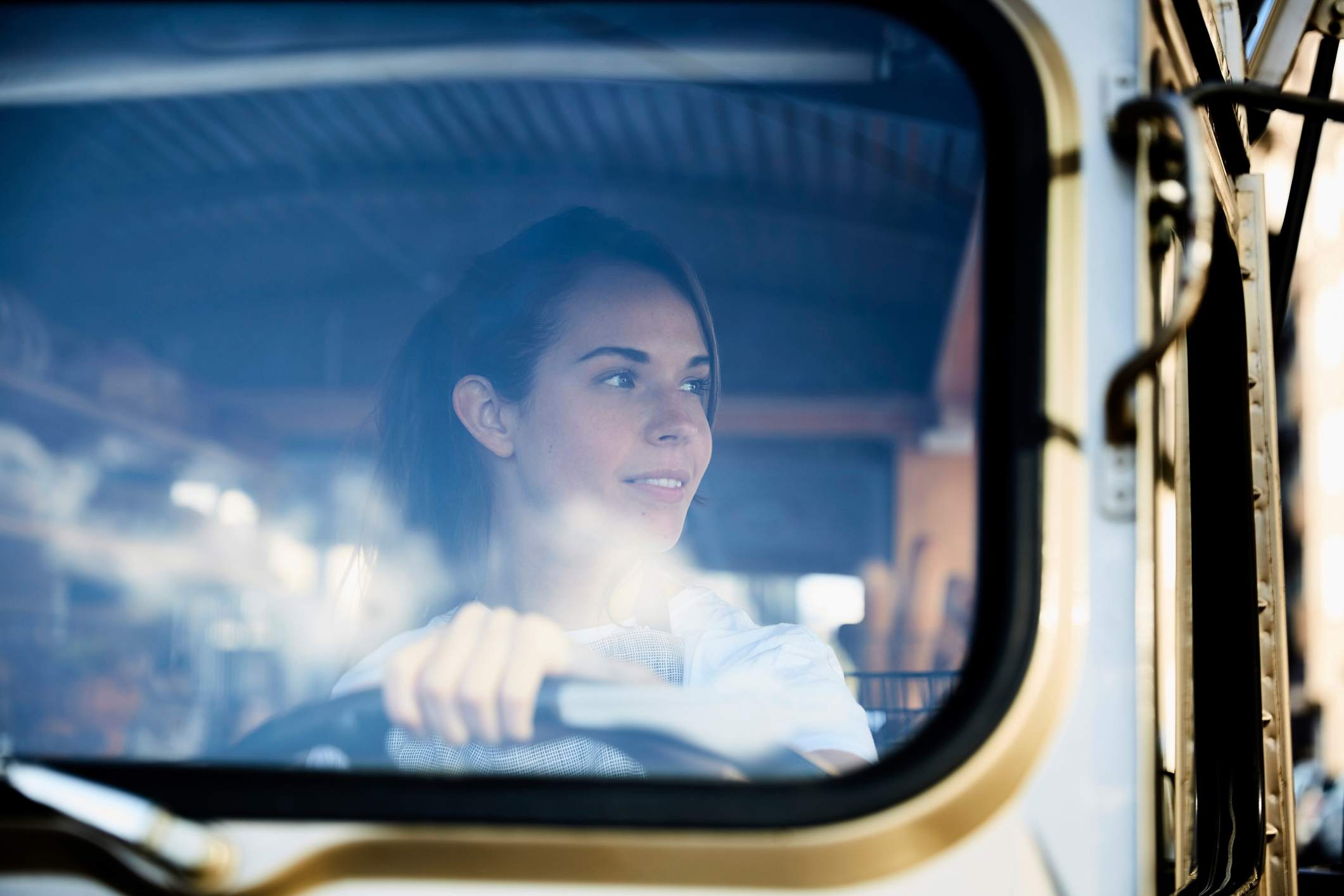 Female truck driver through the windshield