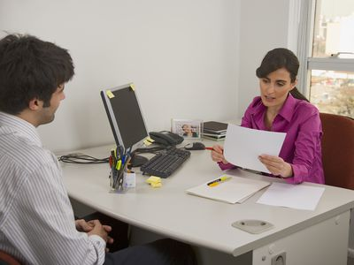 Manager interviewing potential employee in an office