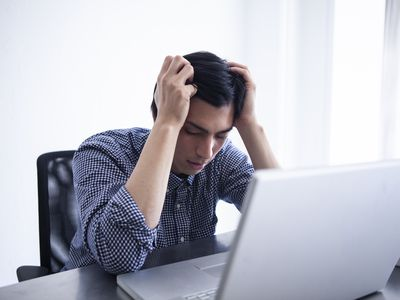 Male employees troubled with their heads