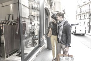 Couple window shopping in Paris