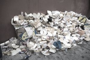 Discarded foam packaging stacked on concrete
