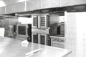 Stainless steel appliances in restaurant kitchen