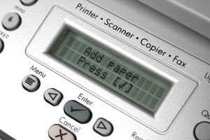 Close-up of a printer with add paper warning message.Similar Images: