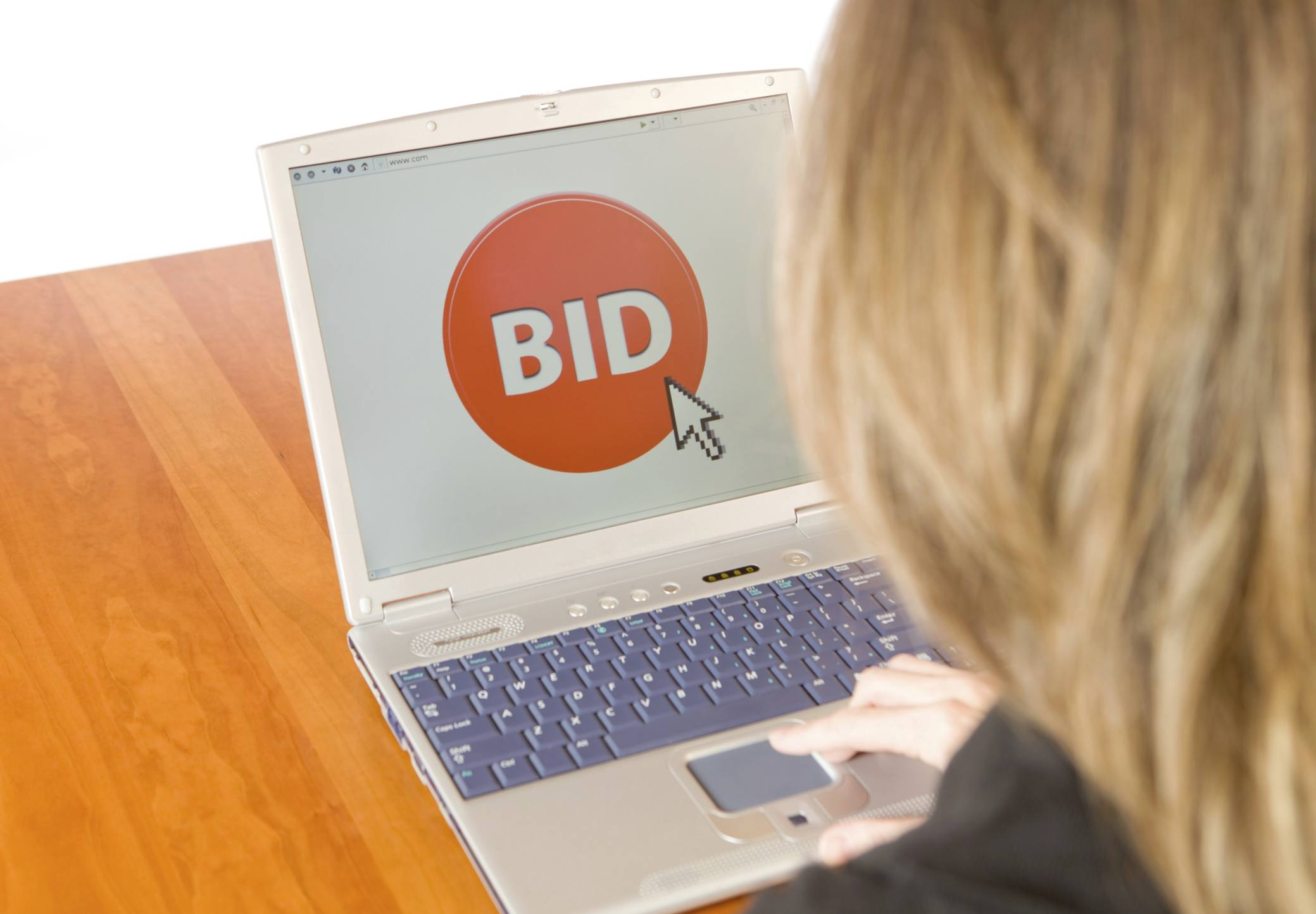 Woman ready to bid at an online auction