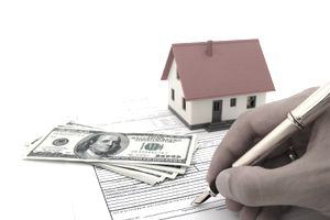 A real estate customer signing a mortgage with a golden fountain pen.