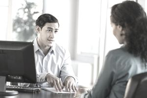 a business man and woman meeting in an office