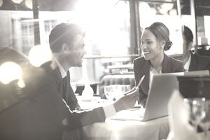 Two business people talking in restaurant