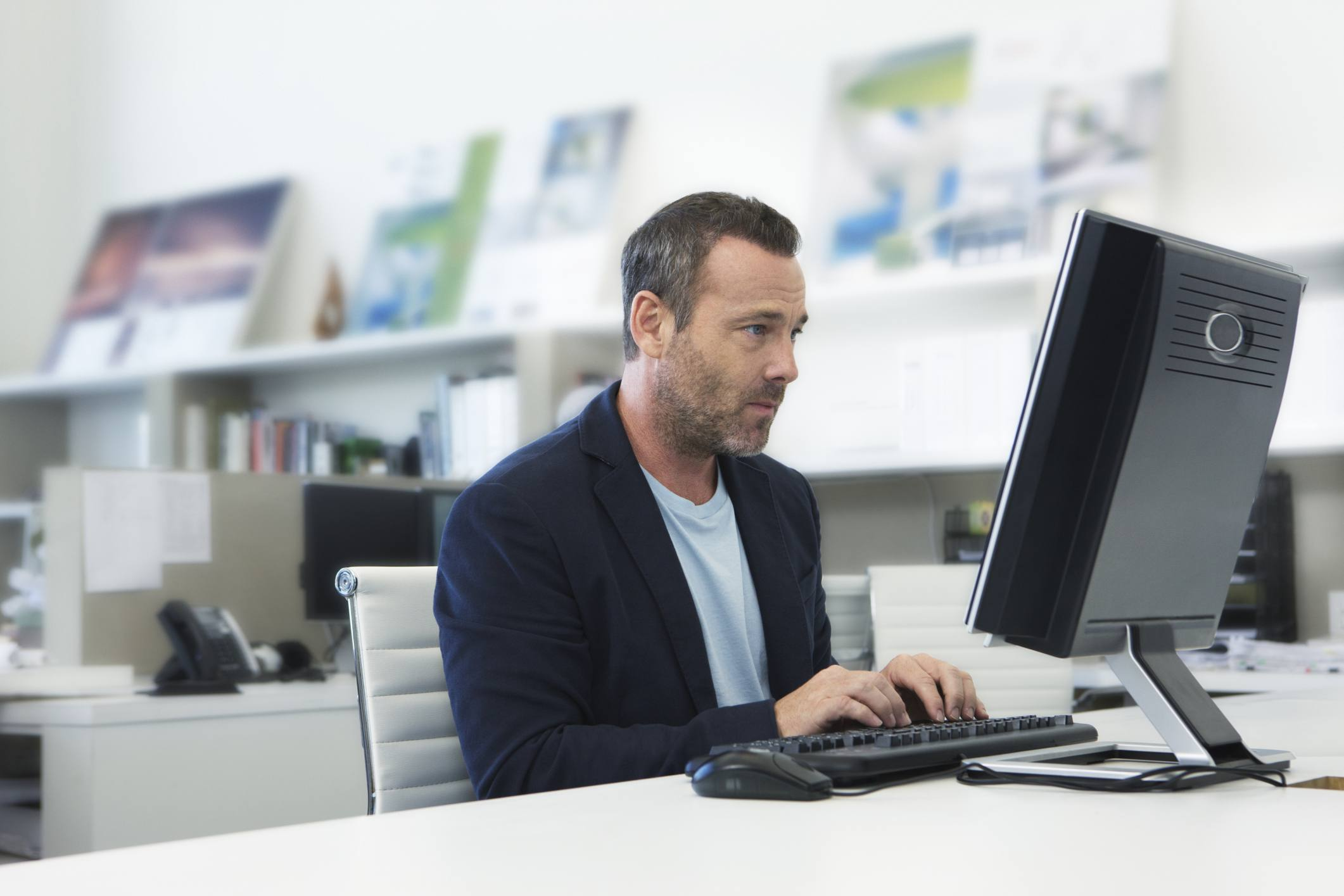 Worker updating software on computer