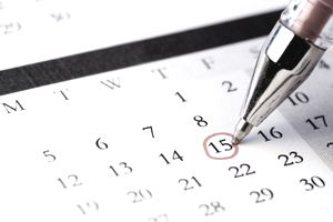 Red Pen Circling Date of the 15th on a White Calendar