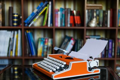 Typewriter on a desk, representing writing a cover letter for a writing job.