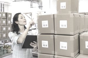 Woman taking Inventory in a warehouse