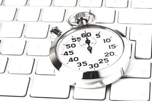 a stopwatch on a computer keyboard