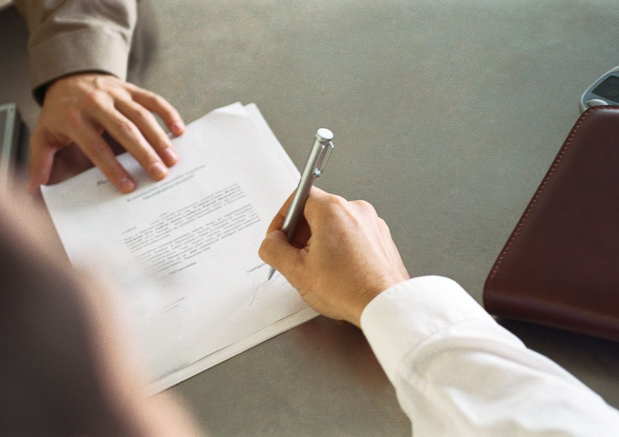 Man signing a consulting contract