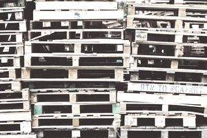 Full frame shot of stacks of empty pallets