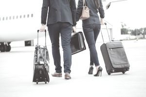 Business colleagues walking towards the airplane