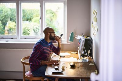 Man using Slack while working from home
