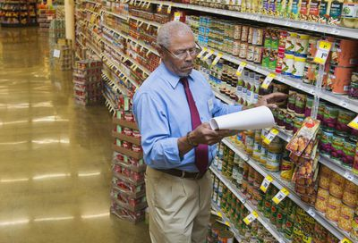 Grocery store manager in an aisle