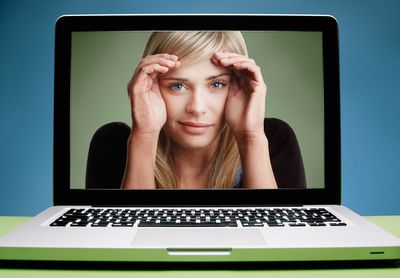 Woman looking out from inside a laptop screen