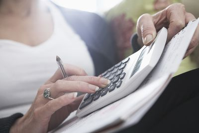 woman using calculator to calculate markup