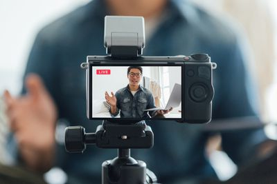 Man vlogging with use of video camera