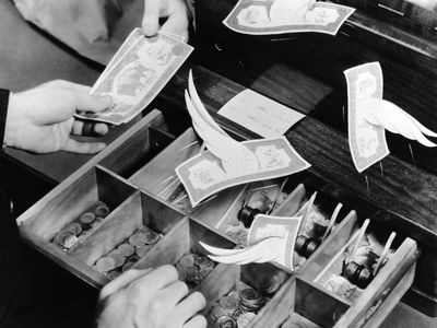 Money flying out of a cash register