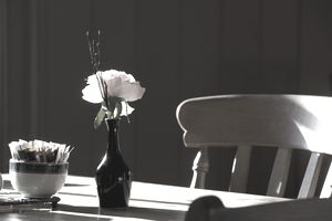 A Single Rose Sits In A Small Vase On A Restaurant Table; Northumberland England