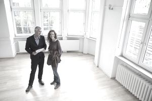Realtor showing a bright and airy apartment to a prospective tenant