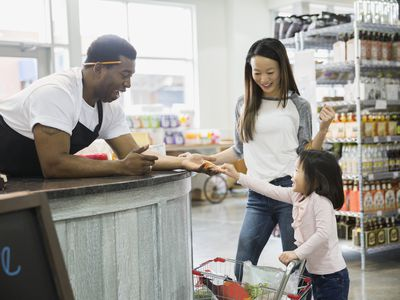 Mother and child shopping during small business Saturday