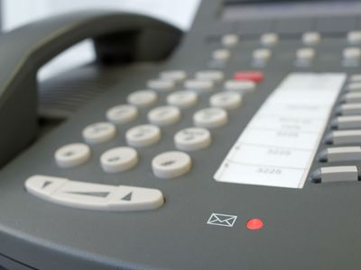 Voice Mail light glows on Business Phone