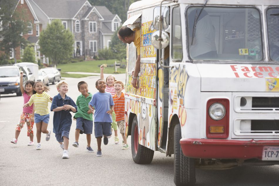 Children (4-8) running towards ice cream truck