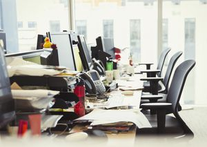Messy row of desks in office