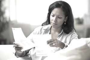 A woman going through a set of invoices
