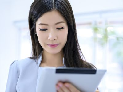 Business woman looking at media outreach plan on her tablet