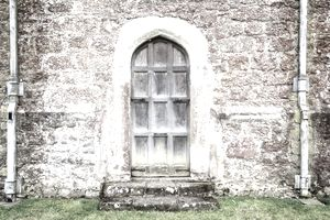 A wooden door in a stone wall