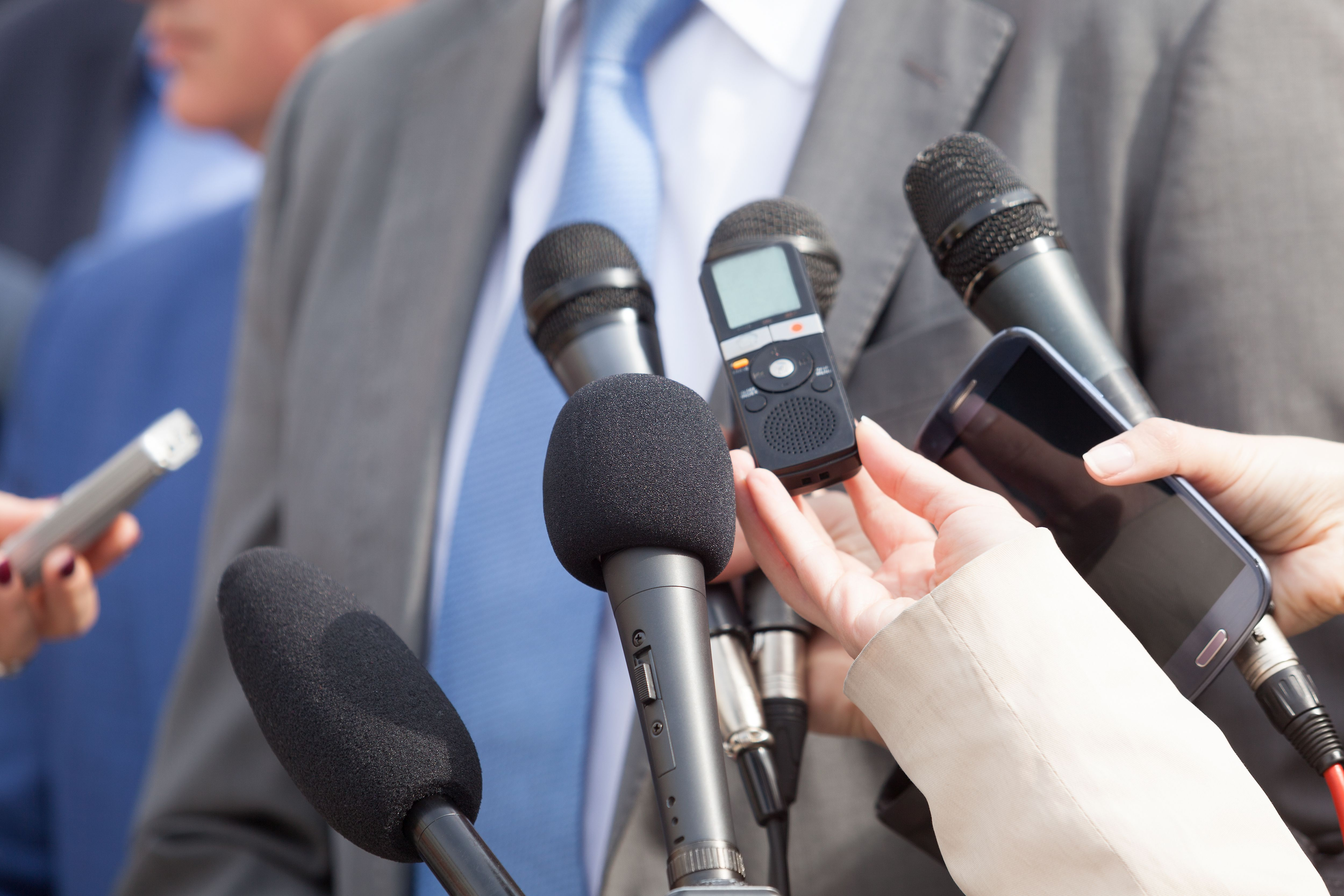 Cropped Image Of Journalists Interviewing Businessman