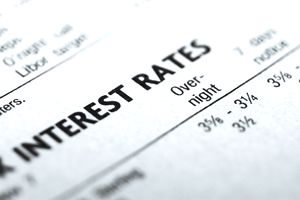 Close-up of a financial paper listing interest rates