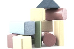 Colored wooden building blocks arranged in a stack