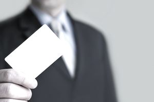 Business man offering a business card to a prospect client
