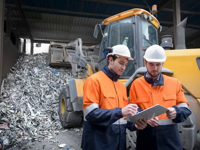 Scrap workers in a recycling plant.