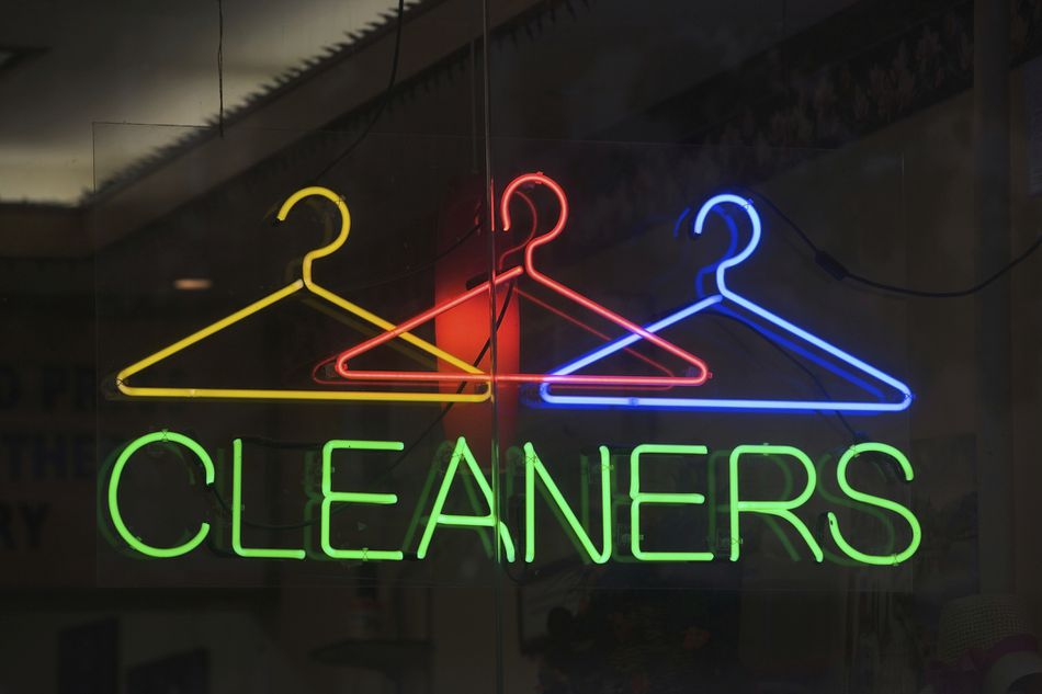 Neon sign reading 'cleaners' in window