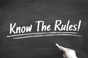 Know The Rules written in chalk, referring to laws and regulations that should be followed.