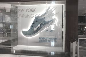 storefront with ad for Nike Second-Skin Fit shoes