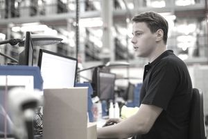 man working on lawson ERP in warehouse