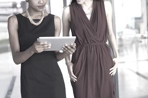 Cropped shot of two businesswomen working together on a digital tablet in an office