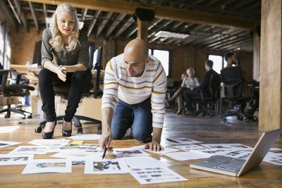 designers looking at images in studio