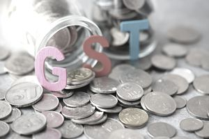 High angle view of GST text on coins