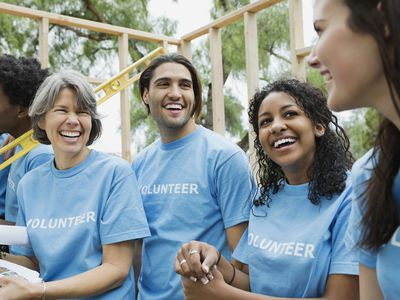 Volunteers of several ages and ethnicities enjoying their work.
